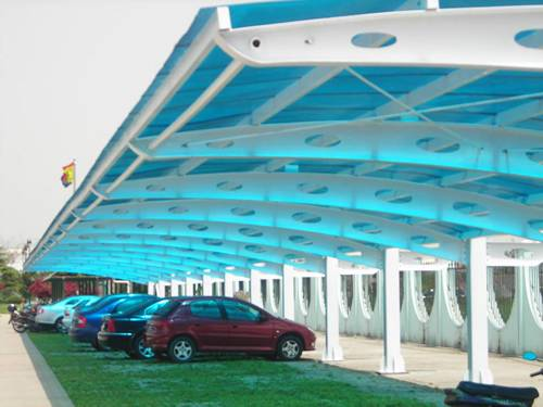 Blue double wall twin wall polycarbonate sheets are formed a shelter for bicycle parking.