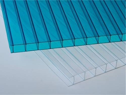 A blue and a white twin-wall polycarbonate sheets on the gray background.